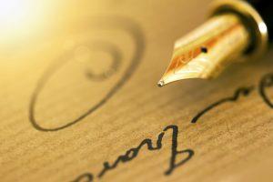 תרגום פטנטים בתמונה: עט נובע וחתימה